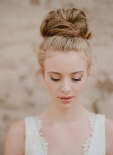bride with a simple top bun