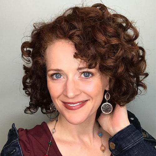 woman with short curly red hair