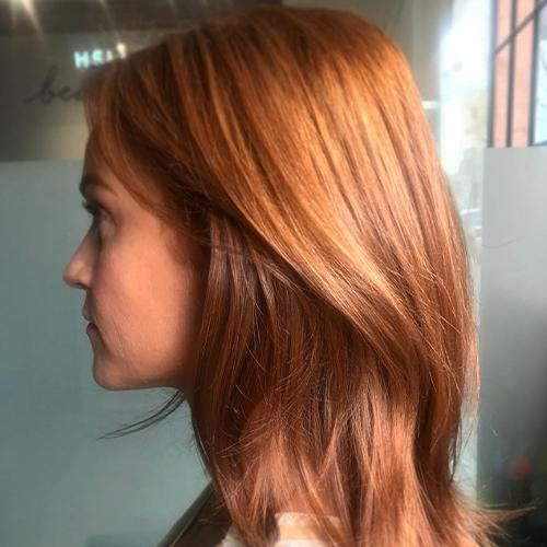 Side profile of woman with red hair