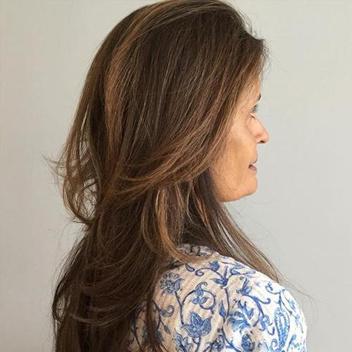 Straight haired woman showing Novara light brown hair color example