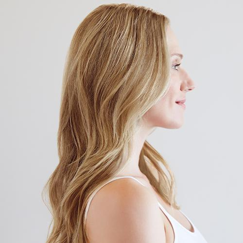 Wavy haired woman showing Lusia blonde hair color example