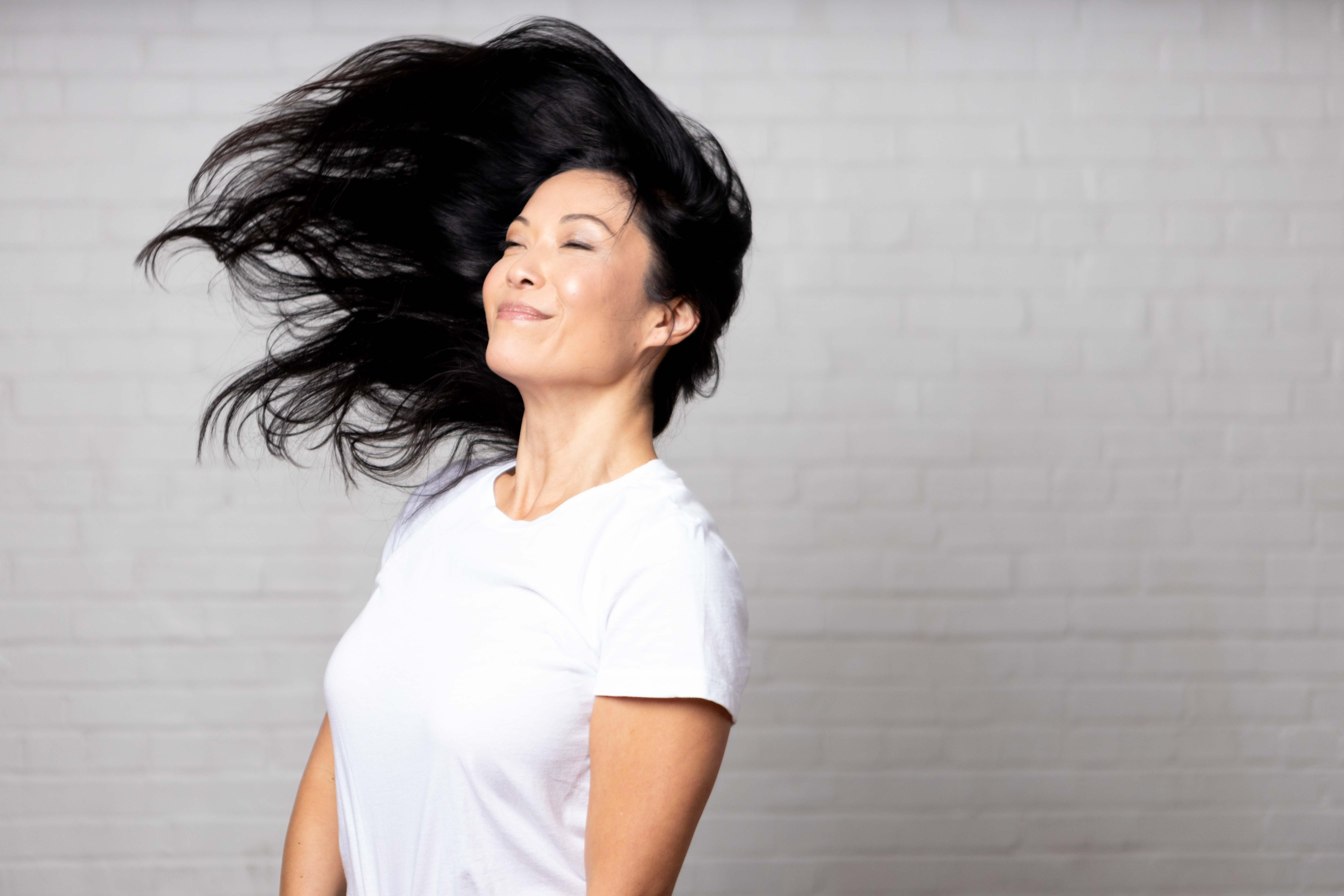 Smiling woman with hair blowing